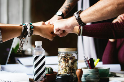 sales process coaching - fist bump